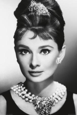 Audrey Hepburn - as Holly Golightly