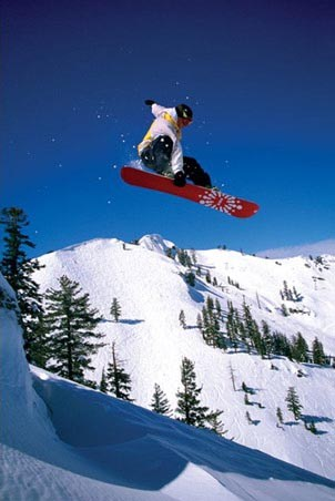 Snowboarder performing an Indy Grab - Snowboard Tricks