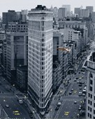 A Flight Past the Flat Iron Building New York City